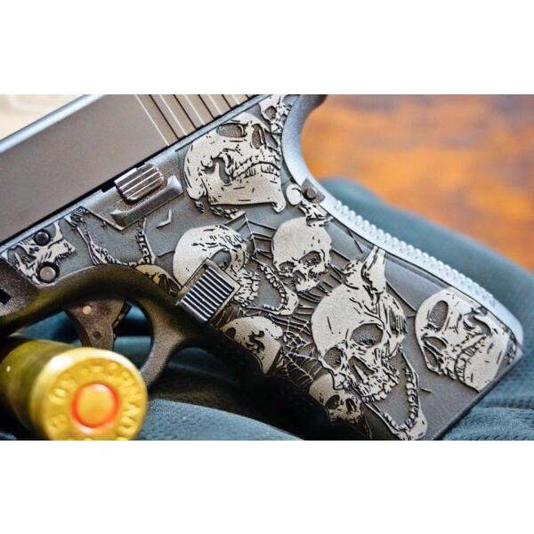 glock handgun grip with skull decoration