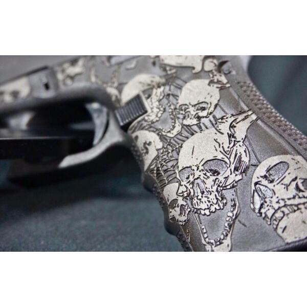 glock handgun with skulls decoration