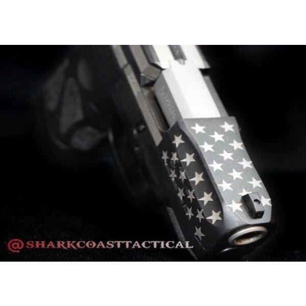 barrel of taurus handgun with flag decoration