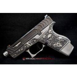 glack handgun with skull decoration