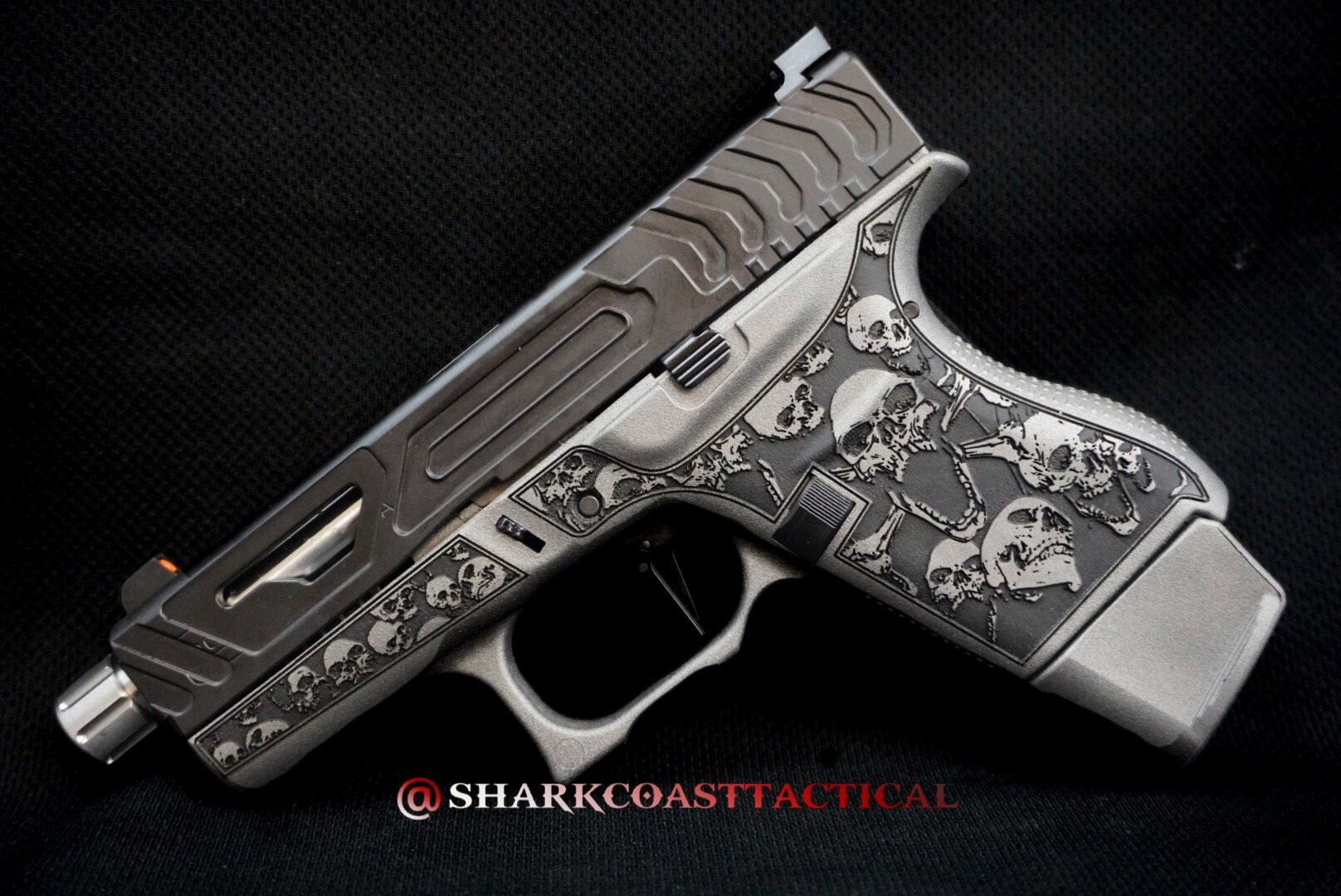 glack handgun with skull decoration