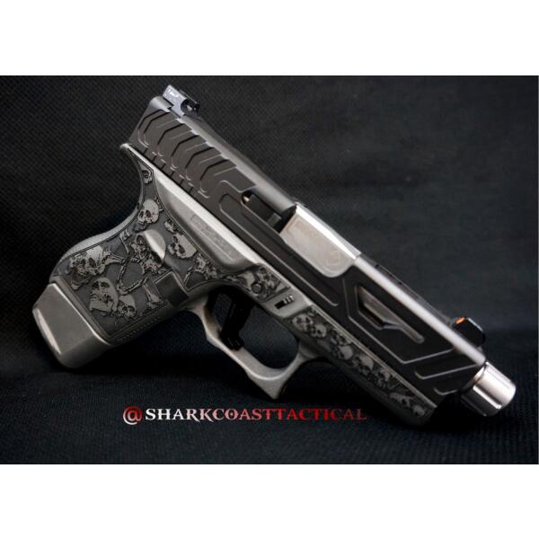 glock handgun with skull decoration