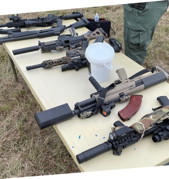 Table with assorted guns